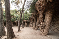 Colonnaded pathway in Park Guell, Barcelona, Spain. Barcelona, Spain - September 20, 2014: Colonnaded pathway. Road projects out from the hillside and forming a Royalty Free Stock Photography