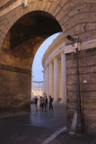 Colonnades of St. Peter s Square, Rome at evening Royalty Free Stock Image