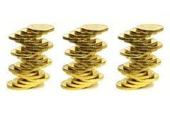 Colonne dalle monete di metallo giallo Fotografia Stock