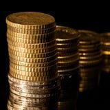 Colonne delle monete dorate Immagine Stock Libera da Diritti