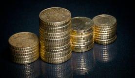 Colonne delle monete dorate Immagini Stock