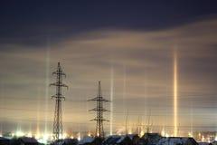 Colonne di indicatore luminoso dalle lanterne in inverno Fotografie Stock