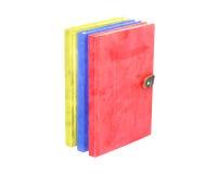 Coloré avec des couleurs primaires sur l'isolat de livre de couverture dessus Image libre de droits