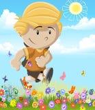 Coloré d'un garçon courant par le gisement de fleur Photo libre de droits