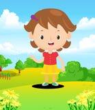 Coloré d'une petite fille heureuse dans le domaine Photos libres de droits