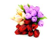 Coloré de la tulipe artificielle fleurit le bouquet sur le fond blanc Photos stock