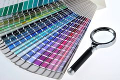 Color. Card and a magnifier been used as nuance standard Royalty Free Stock Photo