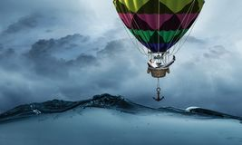 Businessman travel on air balloon royalty free stock image