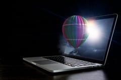 Color aerostat on laptop screen. Mixed media Stock Photo