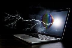 Color aerostat on laptop screen. Mixed media Royalty Free Stock Image