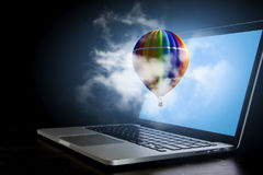 Color aerostat on laptop screen. Mixed media Stock Photography