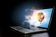 Color aerostat on laptop screen. Mixed media Stock Image