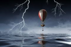Air balloon over water. Mixed media Stock Photo