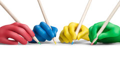 Color agreement-1. Multicolored plasticine hands with a pencils on a white background Royalty Free Stock Photography