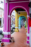 Color architecture narrow streets. Penang, Malaysia. Color architecture narrow streets with people. Dirty moldy humidity cityscape royalty free stock image