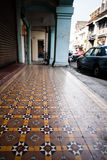 Color architecture narrow streets. Penang, Malaysia. Color architecture narrow streets with people. Dirty moldy humidity cityscape royalty free stock photo