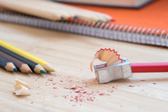 Color art pencils with sharpener and notebook Stock Photo