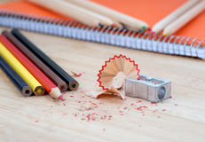Color art pencils with sharpener and notebook Royalty Free Stock Photography