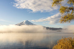 Color of autumn leaves  and Mt.Fuji  at Lake Kawakuchi. Color of autumn leaves  and Mt.Fuji with misty in the morning at Lake Kawakuchi Royalty Free Stock Images