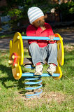 Color baby on the swing. A black child on the swing Stock Photography