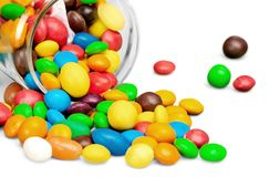 Colorful candies on white background. Color background colorful candies button shaped white circle Royalty Free Stock Photos