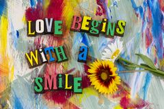 Love begins with smile letterpress. Color background design love begins with smile flower relationship smiling couple family peace kindness joy harmony art stock images