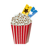 color background with popcorn container with movie tickets inside Stock Photography