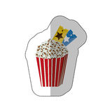 Color background sticker of popcorn container with movie tickets inside Royalty Free Stock Image