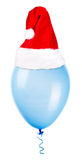 Color balloon with santa hat Royalty Free Stock Images