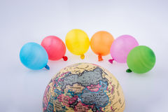 Color balloons and the half a globe Royalty Free Stock Image