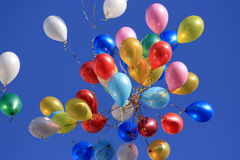 Color balloons in the Sky. A lot of balloons in the blue sky Stock Photos