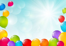 Color balloons on sunny background. Color balloons on blue sunny background Royalty Free Stock Photography