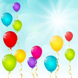 Color balloons on sunny background. Color balloons on blue sunny sky background Royalty Free Stock Images