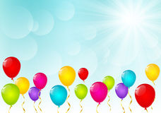 Color balloons on sunny background Stock Photography