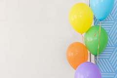 Color balloons on a white background, color balloons at a party, Royalty Free Stock Photo