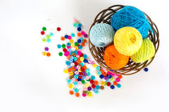 Color balls and buttons. Color balls of thread and buttons for needlework Royalty Free Stock Photography