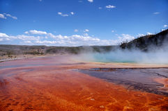 Color Bands, Mud Flats & Tourist. Steam rises off Grand Prismatic Hot Spring with tourist watching from boardwalk - Yellowstone National Park, Wyoming stock photo