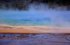 Color Bands and Steam. Steam rises off Grand Prismatic Hot Spring - mud flat in foreground - Yellowstone National Park, Wyoming stock photography
