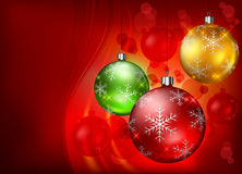 Color baubles on red background Royalty Free Stock Photos