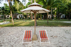 Color beach chairs and white umbrella Stock Photography