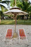 Color beach chairs and white umbrella Royalty Free Stock Photos