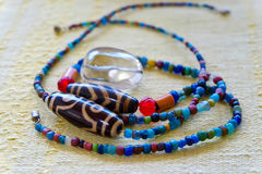Color beads necklace. Wooden and magnetic beads necklace detail Stock Image