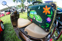 Color beautiful with Volkswagen beetle suitcase on the seat of a moped Stock Images