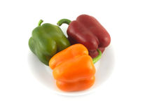 Color beel peppers on plate isolated close up Royalty Free Stock Photos