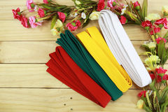 Color belt of martial art on wood floor Royalty Free Stock Photography