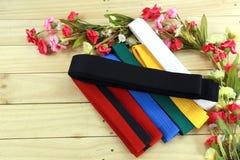 Color belt of martial art on wood floor Stock Image