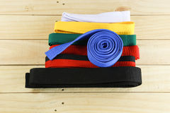 Color belt of martial art on wood floor Stock Photography