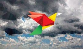 Color bird in cloudy sky Royalty Free Stock Photos