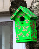 Color birdhouse on a tree in the city Royalty Free Stock Photography
