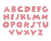 Color blanco de la fuente del alfabeto del bastón de caramelo y rosado rojo Fotos de archivo
